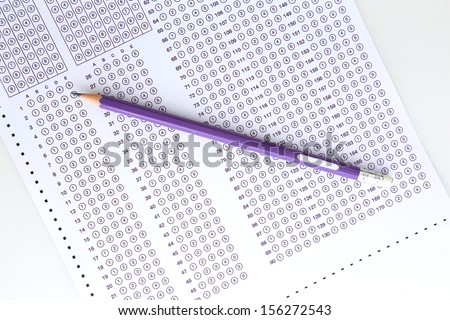 Purple answer sheet with purple pencil  - stock photo
