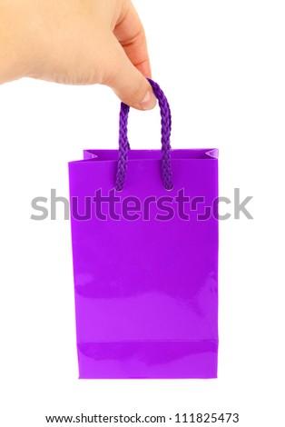purple bag and Caucasian hand - stock photo