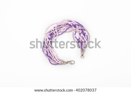Purple beaded bracelet - stock photo
