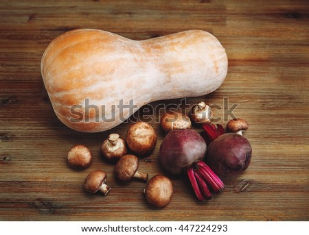 Purple Beets,Pumpkin,Fresh Mushrooms on the Wooden Table.Autumn Garden's Vegetable Background.Top View - stock photo