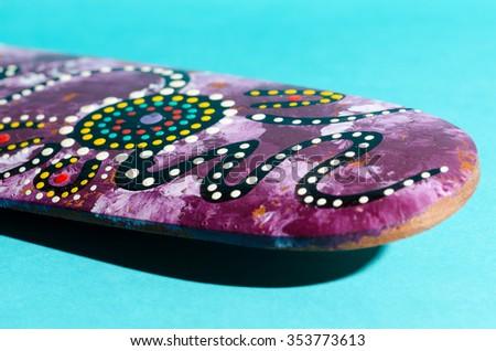 Purple boomerang on aqua - stock photo