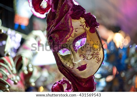 purple carnival mask for sale in the shop,  Venice, Italy - stock photo