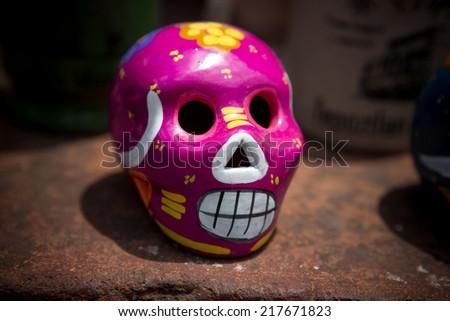purple ceramic skull - stock photo