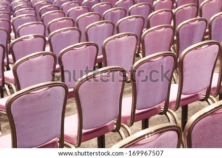 purple chairs in a conference room - stock photo