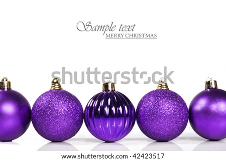 Purple christmas baubles on white background with space for text - stock photo