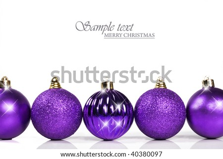 Purple christmas baubles with space for text - stock photo