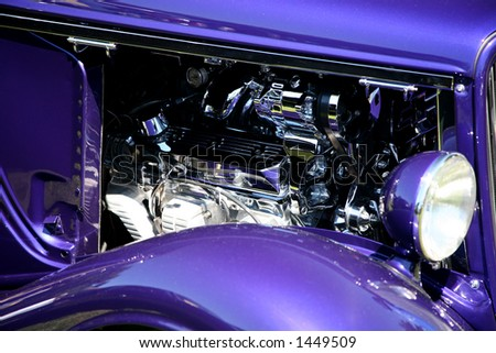 Purple Classic Car with Chrome Engine - stock photo
