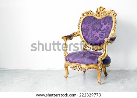 Purple classical style Armchair sofa couch in vintage room - stock photo