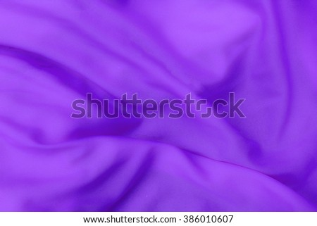 Purple cloth background abstract with soft waves. - stock photo