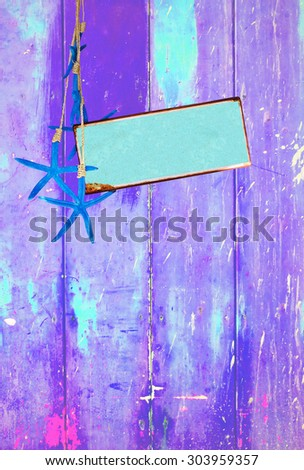 Purple colorful vintage background with shabby distressed grungy texture hippie style, blue sea stars  and turquoise metal plate for text message. - stock photo