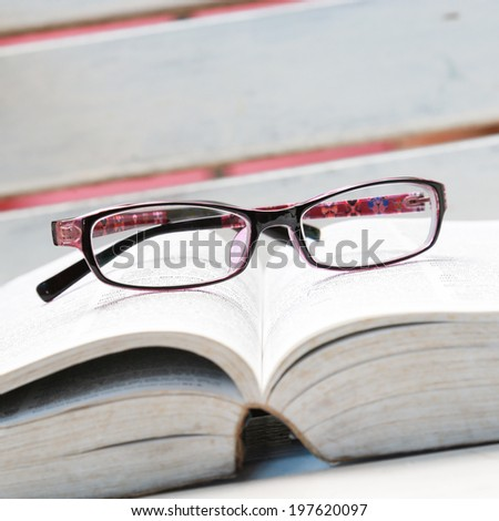 purple eyeglasses - stock photo