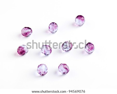 purple glass beads closeup on white background - stock photo
