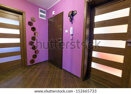 Purple hall interior with brown tiles - stock photo