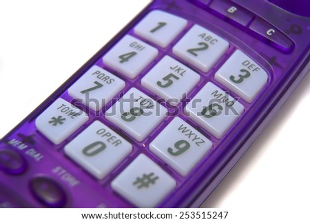 Purple handset closeup on white background - stock photo