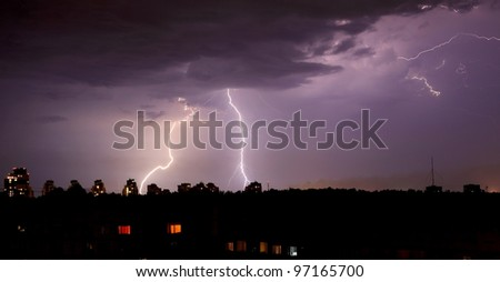 purple lightning bolts in the night skies - stock photo
