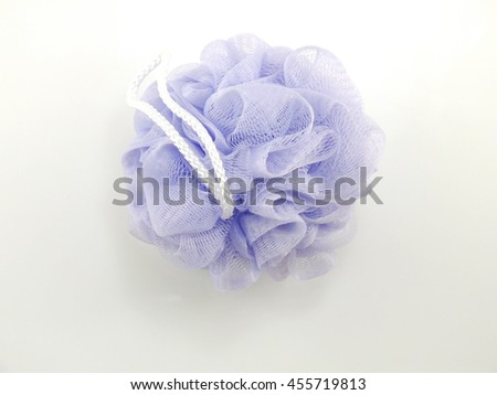 purple  plastic bath puff for shower cleaning and scrub body - stock photo