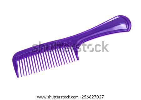 purple plastic comb on a white background - stock photo