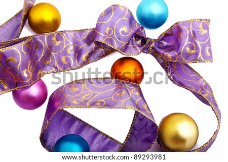 Purple ribbon with colourfull christmas balls isolated on white - stock photo