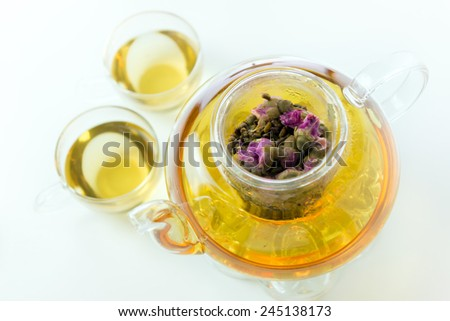 Purple rose and cassia seed herbal glass tea pot - stock photo