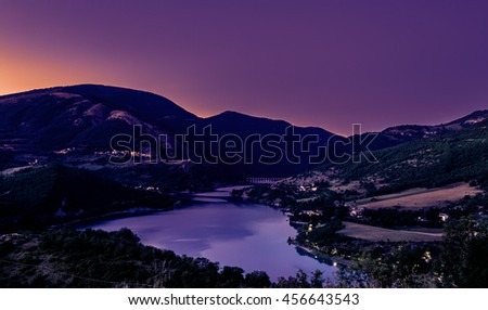 purple sunset on Fiastra lake. Italy mountain scenic landscape - stock photo