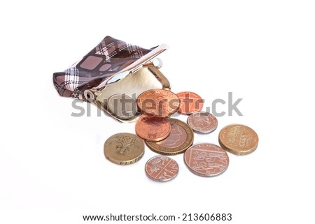 Purse and some english coins isolated on white background - stock photo