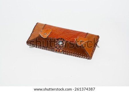 purse is photographed in studio on a white background - stock photo
