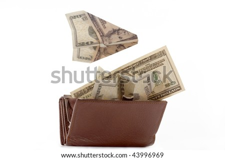 Purse with denominations of dollar on a white background. - stock photo