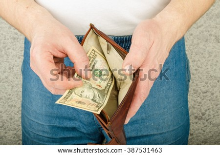 Purse with money in hands - stock photo