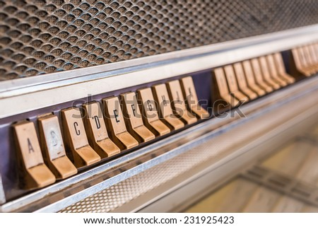 Push button juke box have dust and stain (use selective focus) - stock photo