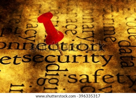 Push pin on security word cloud - stock photo