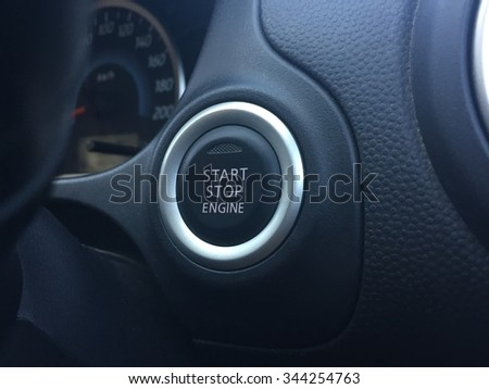 Push start and stop engine in car. - stock photo