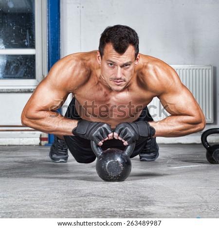 push up on kettlebells fitness training - stock photo