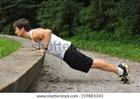 Push ups in the park  - stock photo