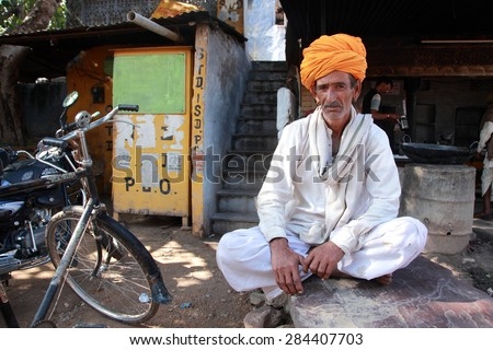 PUSHKAR, INDIA - NOV 18: An unidentified villager wearing a traditional Rajasthani turban participates in Pushkar Fair on November 18, 2010 in Pushkar, Rajasthan, India.  - stock photo