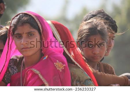 Pushkar, India, November 28, 2012: Beautiful Indian girl with pink veil at Pushkar fair, in the Indian Rajasthan state - stock photo
