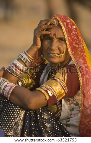 PUSHKAR, INDIA - NOVEMBER 9: Unknown indian lady in traditional tribal dress on November 9, 2008 at the annual camel fair in Pushkar, Rajasthan, India. - stock photo