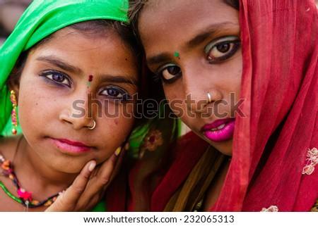PUSHKAR,INDIA - October 31,2014 : Unidentified young Indian women dress their colorful and traditional scarfs in Pushkar Mela (Pushkar Camel Fair ). - stock photo