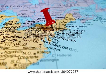 pushpin marking on New York map - stock photo