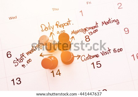 Pushpin on calendar with busy day overworked schedule with filter. - stock photo