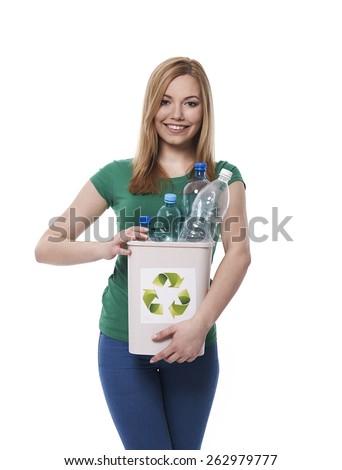 Put plastic bottle for right bin - stock photo