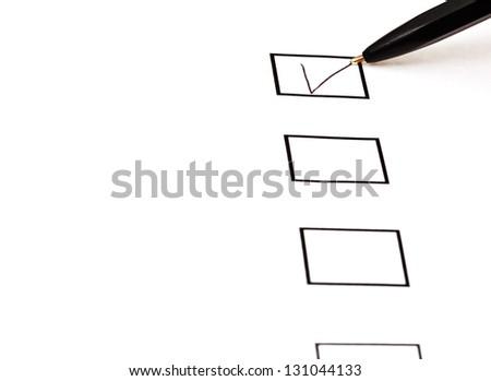 put tick in black square box by simple black ballpoint pen - stock photo