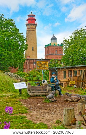 PUTGARTEN, GERMANY - JUNE 22, 2012: Lighthouse at Kap Arkona with captain sculture. A famous tourist destination on the island of rugia. - stock photo