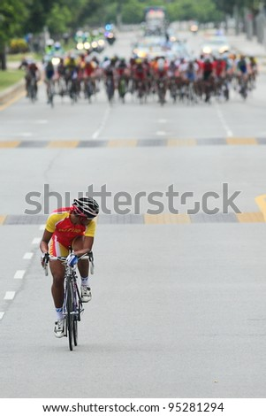 PUTRAJAYA- FEB 16 : Cyclist from Vietnam breakout from the main peloton in 120km Road Race (MJ) during the 32nd Asian & 19th Junior Asian Cycling Championships on Feb 16, 2012 in Putrajaya,Malaysia - stock photo
