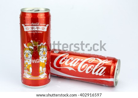 PUTRAJAYA, MALAYSIA - APRIL 8, 2016. Coca cola drink isolated on white. Coca cola drinks are produced and manufactured by The Coca-Cola Company, an American multinational beverage corporation. - stock photo