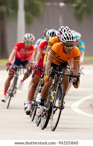 PUTRAJAYA, MALAYSIA - FEB 18: Unidentified cyclists from Malaysia team during in Elite Men's Road Race (179.2km) at the 32nd Asian & 19th Junior Asian Cycling Championships on Feb 18, 2012 in Putrajaya, Malaysia. - stock photo