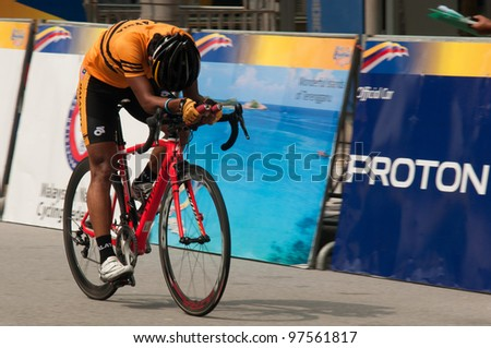 PUTRAJAYA, MALAYSIA - FEBRUARY 24: An unidentified cyclist participates in Stage 1 of the Putrajaya Individual Time Trial for the 2012 Le Tour de Langkawi on Feb. 24, 2012 in Putrajaya, Malaysia - stock photo