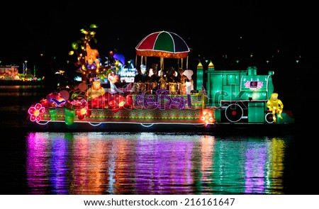 PUTRAJAYA, MALAYSIA- JUNE 21, 2014 :Sabah floats cruising at lake during FLORIA night show in Putrajaya, Malaysia, showcasing their own unique tourism attraction. - stock photo