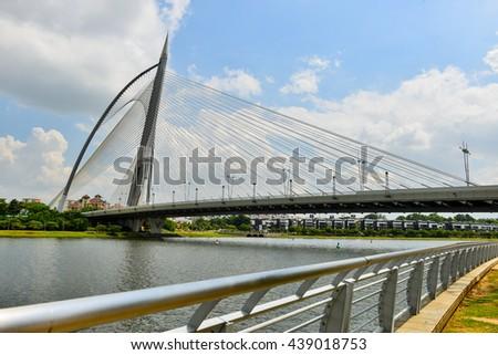 PUTRAJAYA, MALAYSIA - JUNE 11, 2016: Seri Wawasan Bridge on June 11, 2016 in Putrajaya. It is a 370m long bridge which is built across the Putrajaya Lake in Putrajaya. - stock photo