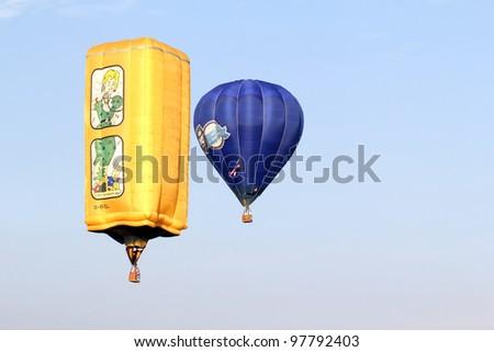 PUTRAJAYA, MALAYSIA-MAR 16: Hot Air balloon in flight at the 4th Putrajaya International Hot Air Balloon Fiesta Mar 16, 2012 in Putrajaya. - stock photo