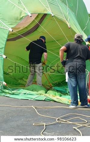 PUTRAJAYA, MALAYSIA-MAR 17:Hot air balloon is being shut down at the 4th Putrajaya International Hot Air Balloon Fiesta on Mar 17, 2012 Putrajaya. The event held in Precinct 2, Putrajaya, Malaysia. - stock photo